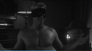 Nelson Gardner shirtless and with his mask on in S1 E6