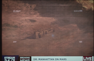 Dr Manhattan destroying the lifesize sand castle on Mars