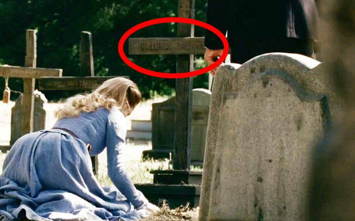 Dolores at her grave.jpg