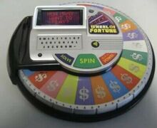 Irwin-Toy-2009-Wheel-Of-Fortune-Electronic-Handheld.jpg