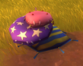 Purple Star Pillow Pile.png