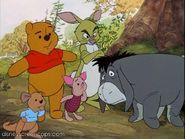 Pooh and his friends looking at Tigger