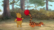 Winnie the Pooh tells Tigger the red balloon wants to stick with him