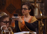 Alex with the phone in Wizard School
