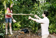 Alex helping justin with a branch