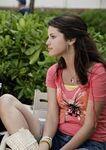 Selena behind the movie sitting