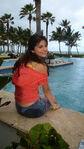 Selena in the pool behind the movie