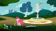 Pinkie Pie sniffing a flower S1E15
