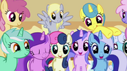 A group of very happy background ponies