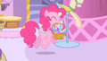 Pinkie Pie carrying a basket filled with feathers S1E20