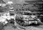 American armored vehicles crossing the Muhl River near Neufelden, Austria, May 4, 1945