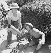 A 4.2-inch mortar of 1st Infantry Brigade's support group, firing in support of the 5th Northamptonshire Regiment in the Anzio bridgehead, Italy, 18 May 1944. NA15216