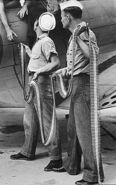US Navy personnel loading .30-06 belts into an SBD-3, Naval Air Station Norfolk, VA, 1942