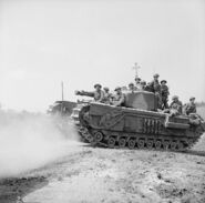 Churchill with infantry moving to St. Pierre Tarentaine, Normandy, August 3, 1944
