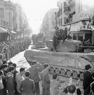 Churchill tank and allied trucks parade through liberated Tunis, May 8 1943