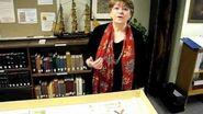 Marguerite Ragnow examines a Portolan chart