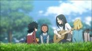 Isabella playing guitar