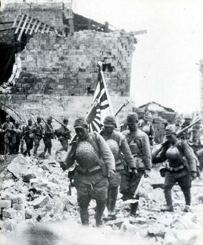 Japanese-troops-in-rubble-of-village.jpg