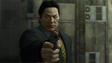 Kanai aims at Akiyama from calling the 999.