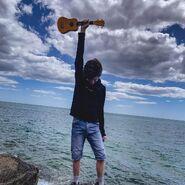 Tubbo with his ukulele